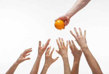 Many hands want to get orange, white background