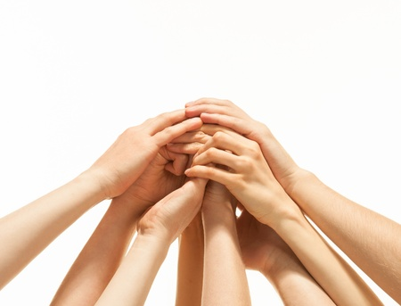 Foto de Successful team: many hands holding together on white background - Imagen libre de derechos