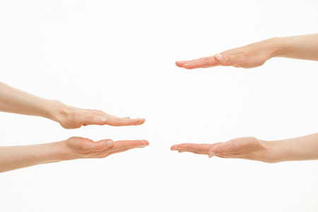 Photo pour Hands showing different sizes - from small to big, white background - image libre de droit