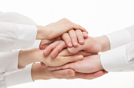 Group of businessmen's hands  on white background