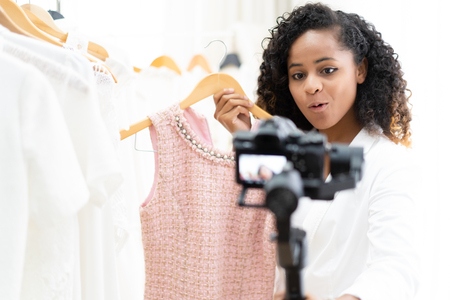 Photo for Young adult woman fashion blogging and shopping shooting selfie video on the mirrorless Camera gimbal. social media concept - Royalty Free Image