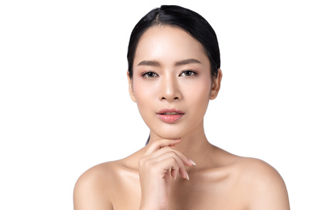 Foto de Beautiful young Asian woman with beauty skin healthy face close up  isolated on white background.  Cosmetology ,beauty and spa . Girl washes and cleans her face. - Imagen libre de derechos