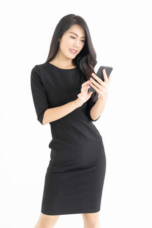 Photo pour Portrait of young Asian businesswoman using mobile phone isolated over white background.Technology, connection, communication, social media concept - image libre de droit
