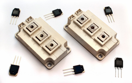 Photo pour Powerful IGBT transistor modules and small transistors on white background - image libre de droit