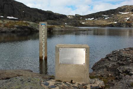 Photo pour Water level gauge in a lake, Norway - image libre de droit