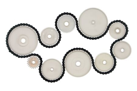 Photo pour White plastic cogwheels and metal chain, isolated on white background. Transmission concept. - image libre de droit