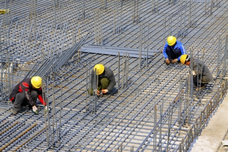 Photo for binding reinforcement mesh workers at a construction site, north china  - Royalty Free Image