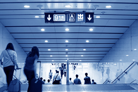 passengers in a subway station in Beijing, China