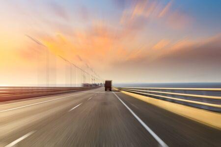 Foto de Blurred motion of truck and asphalt road at dusk - Imagen libre de derechos