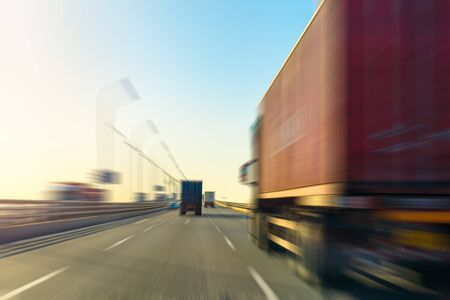 Photo for Blurred motion of truck and asphalt road at dusk - Royalty Free Image