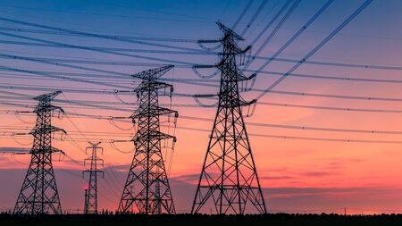 Photo pour High voltage power tower and nature landscape at sunset - image libre de droit