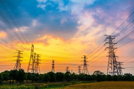 Photo pour Industrial high voltage electricity tower and beautiful nature landscape at summer sunset - image libre de droit
