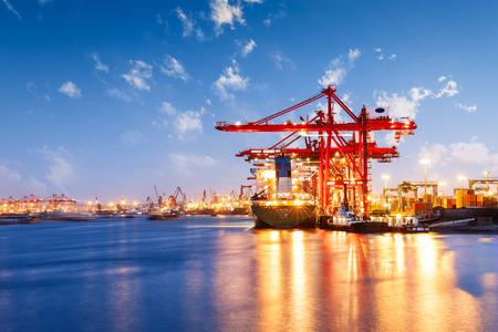 Foto de Industrial container freight Trade Port scene at sunset - Imagen libre de derechos