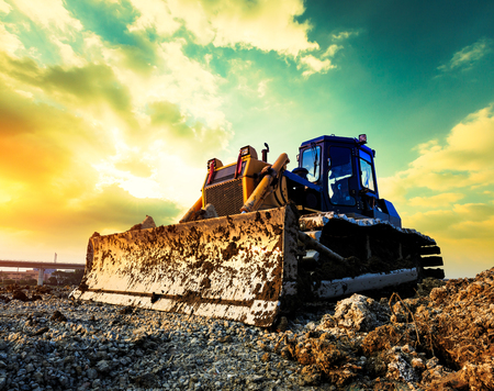 Foto de bulldozer on a building site at sunset - Imagen libre de derechos