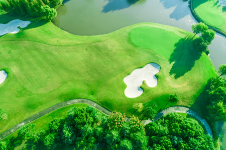 Foto per Aerial photograph of forest and golf course with lake - Immagine Royalty Free