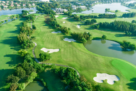 Photo pour Aerial photograph of forest and golf course with lake - image libre de droit