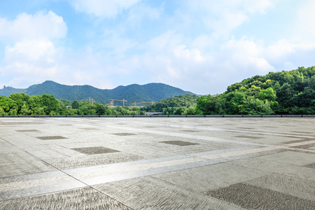 Photo for Empty square floor and green mountain with sky landscape - Royalty Free Image