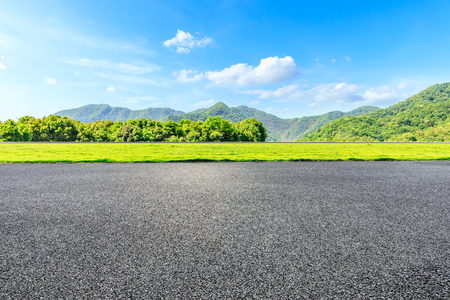 Photo pour Country road and green mountains natural landscape under the blue sky - image libre de droit