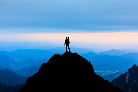 Happy man posing gesture of triumph with hands in the air,conceptual scene