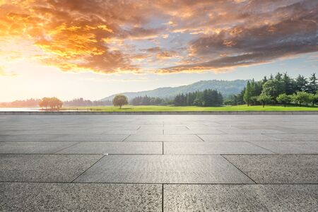 Photo for Empty floor and green woods with mountain natural scenery in city park - Royalty Free Image