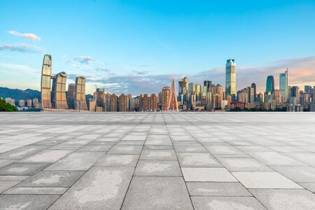 Empty square floor and cityscape with buildings in Chongqing at sunset,China.