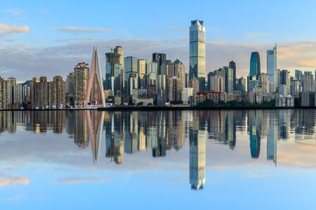 Photo pour Chongqing skyline and modern urban skyscrapers with water reflection at sunset,China. - image libre de droit