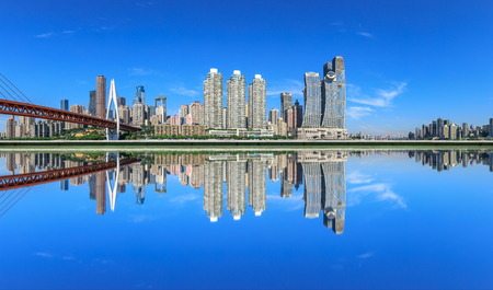 Photo pour Modern city financial district buildings and reflections in the water,Chongqing,China. - image libre de droit