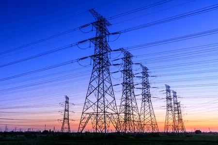 Photo pour High voltage electricity tower sky sunset landscape,industrial background. - image libre de droit