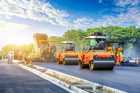 Photo for Construction site is laying new asphalt road pavement,road construction workers and road construction machinery scene. - Royalty Free Image