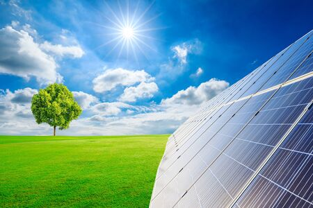 Photo for Photovoltaic solar panels and green grass on sky background,green clean alternative energy concept. - Royalty Free Image