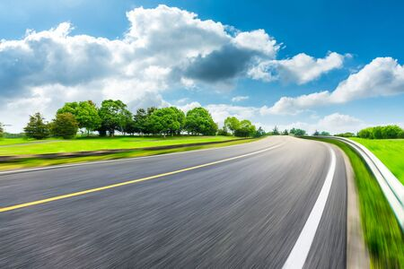 Photo for Fast moving asphalt road and green forest landscape. - Royalty Free Image