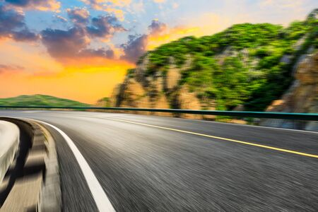 Photo pour Motion blurred road and mountains at sunrise.mountain road background. - image libre de droit