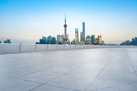 Photo pour Empty floor and modern city skyline with buildings in Shanghai at sunset,China. - image libre de droit