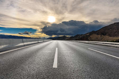 Photo for Asphalt road and mountain with sky clouds landscape at sunrise. - Royalty Free Image