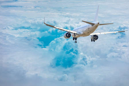 Photo for Commercial airplane flying above blue sky and white clouds. - Royalty Free Image