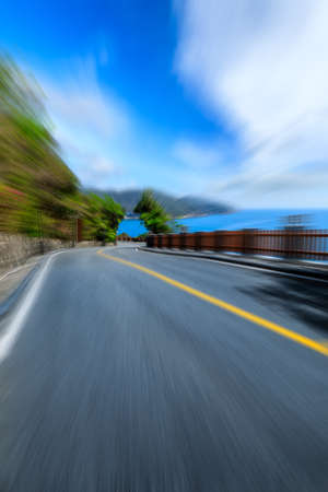 Photo for Motion blurred road with sea landscape. - Royalty Free Image