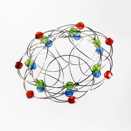 Photo pour Multicolored handmade three-dimensional model of geometric solid on a white background. - image libre de droit