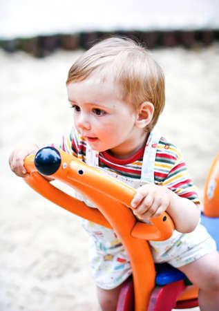 boy swinging   on the  playground