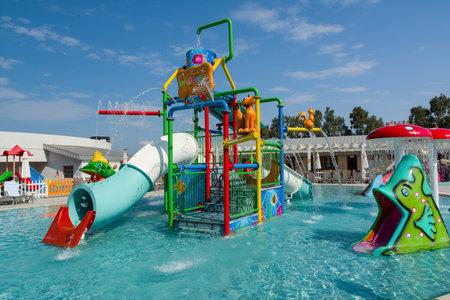 Photo for KUSADASI, TURKEY - AUGUST 21, 2017: Colourful plastic slides in aquapark. Children water playground. - Royalty Free Image