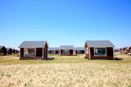 wooden houses landscape view on a grassland