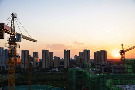 Photo for Tower cranes build residential buildings at nigh - Royalty Free Image