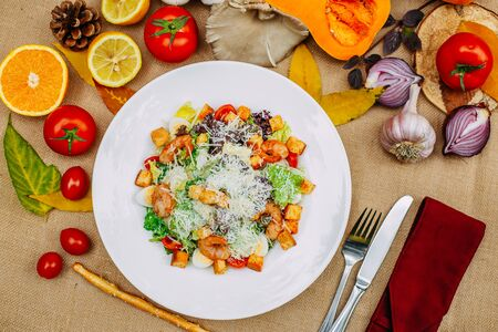 Photo for Autumn table setting with pumpkins. Thanksgiving dinner. shrimp caesar salad - Royalty Free Image