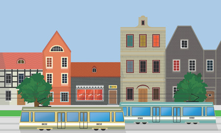 Street of the city, houses and trams.