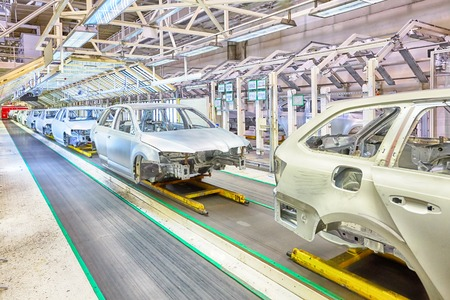 Photo for prepared chassis in a row at car plant - Royalty Free Image