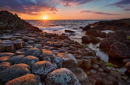 sunset over basalt columns Giants Causeway known as UNESCO World Heritage Site, County Antrim, Northern Ireland