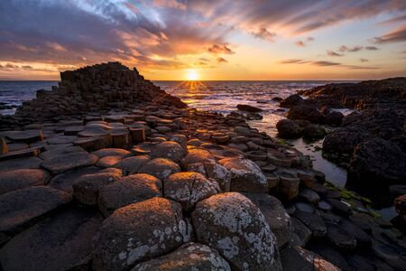 Photo for sunset over basalt columns Giants Causeway   County Antrim, Northern Ireland - Royalty Free Image
