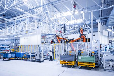 Photo pour robotic arms in a car plant - image libre de droit