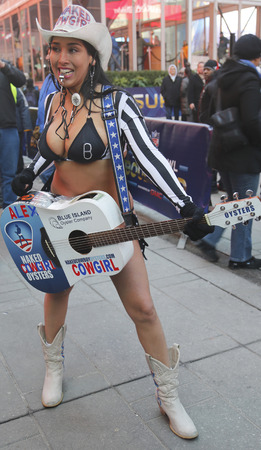 NEW YORK - JANUARY 30 Alex, the Naked Cowgirl, entertains the crowd in Times Square during Super Bowl XLVIII week in Manhattan on January 30, 2014 It is 30 degrees at the present time in New York