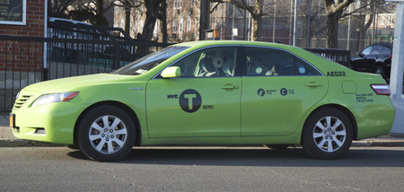 BROOKLYN, NY - MARCH 9  New green-colored  Boro taxi  in Brooklyn on March 9, 2014  New Street Hail Livery vehicles can pick up passengers anywhere outside of Manhattan and in Upper Manhattan
