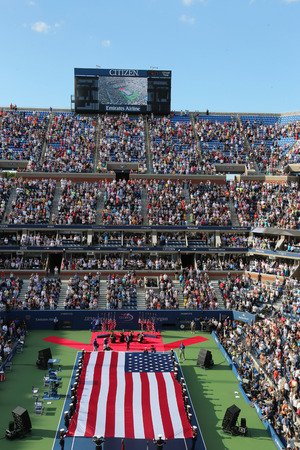NEW YORK- SEPTEMBER 7  US Marine Corps unfurling American Flag  during the opening ceremony of the US Open 2014 women final at Billie Jean King National Tennis Center on September 7, 2014 in New York